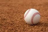 23748583-baseball-on-the-infield-dirt-with-room-for-copy